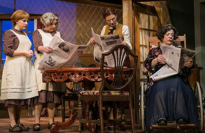 "The ensemble reads newspapers in Georgia Ensemble Theatre's ""Night Must Fall."""