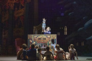 "Kids gather in front of the nutcracker in Atlanta Ballet's ""The Nutcracker"""