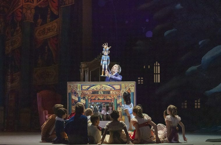 "Kids gather in front of the nutcracker in Atlanta Ballet's ""The Nutcracker"""