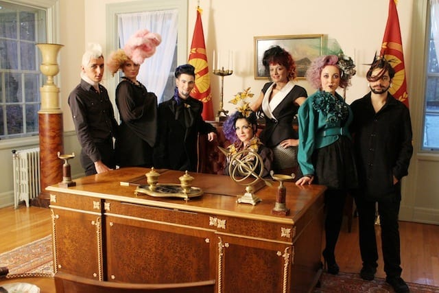"Models dressed as ""Hunger Games"" Capitolites gather around the desk of President Snow during the Swan House Capitol Tours preview. (Photo by Trevor Beemon)"