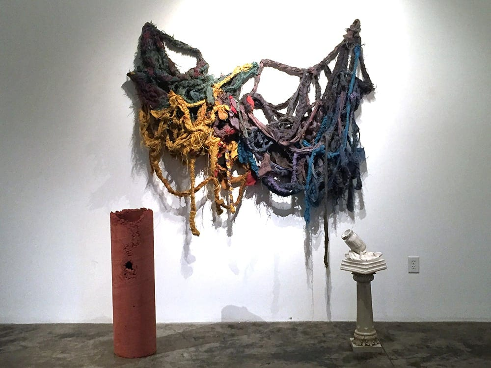 Heracles and Atlas: Buckles in the Weight of It All; stereoscopic lightbox; jute, thread, concrete, plaster, found materials; 2016