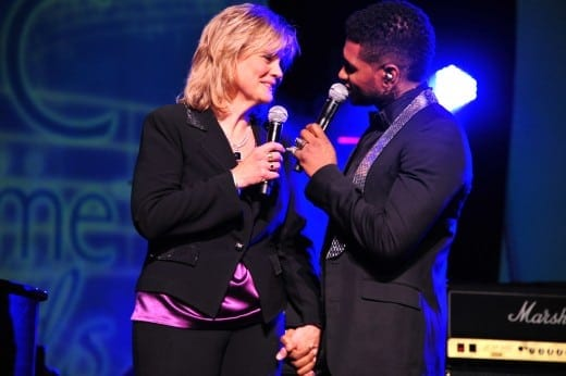When Jan Smith was inducted into the Georgia Music Hall of Fame in 2011, Usher surprised her by showing up to sign Georgia on my Mind with her on stage. (Photo courtesy Jan Smith)