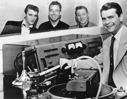 Sam Phillips (right) with Elvis Presley, bassist Bill Black (middle) and guitarist Scotty Moore at the Sun studio in 1955. Credit: Sam Phillips Family.