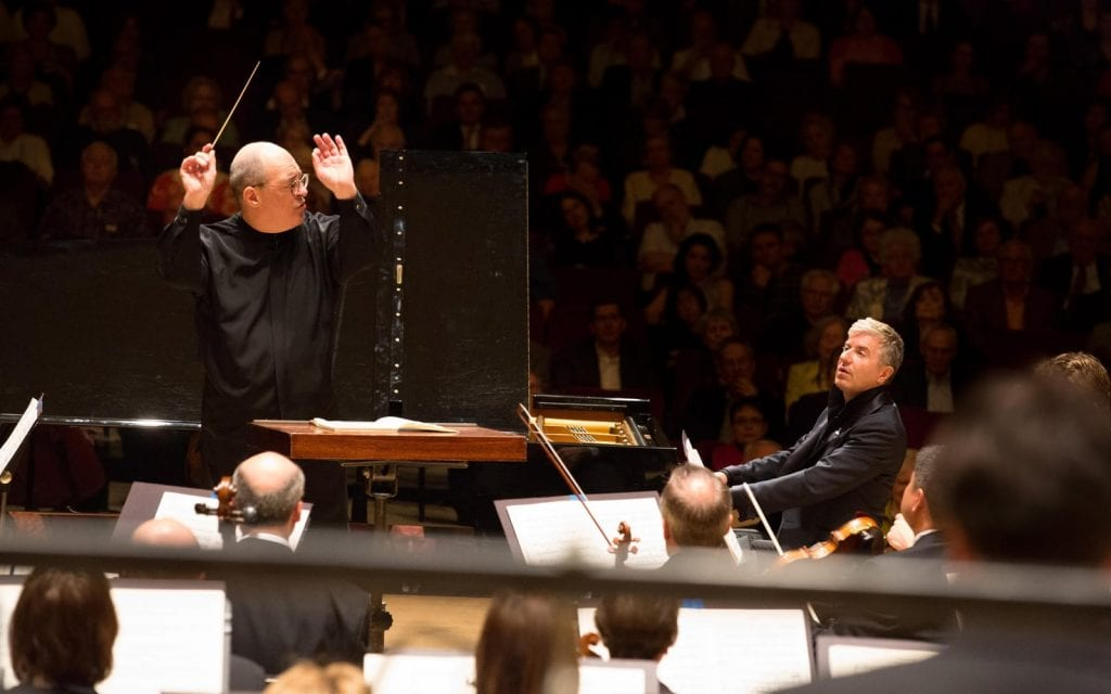 Robert Spano, left, conducts as Thibauder digs into Ravel. (Photos by Jeff Roffman)