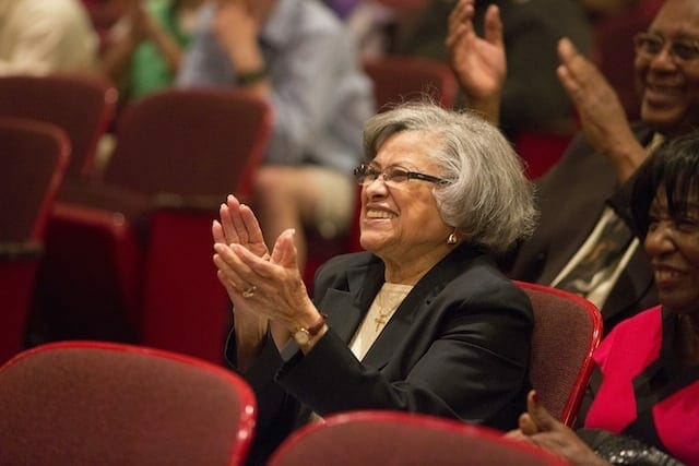 Azira G. Hill sits in the audience in Symphony Hall.