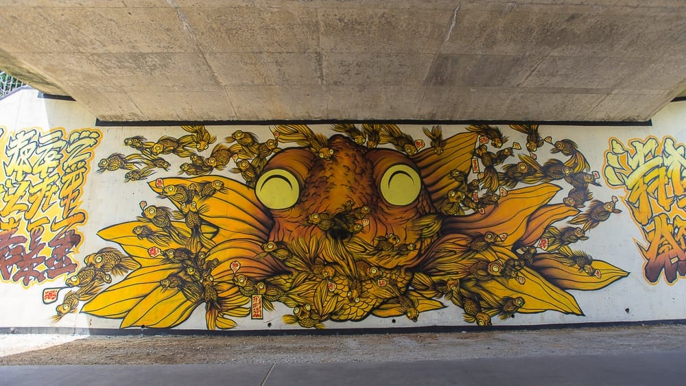 "Brandon Sadler. ""How Are You?"" under the Virginia Ave bridge by Piedmont Park. Image courtesy the artist."