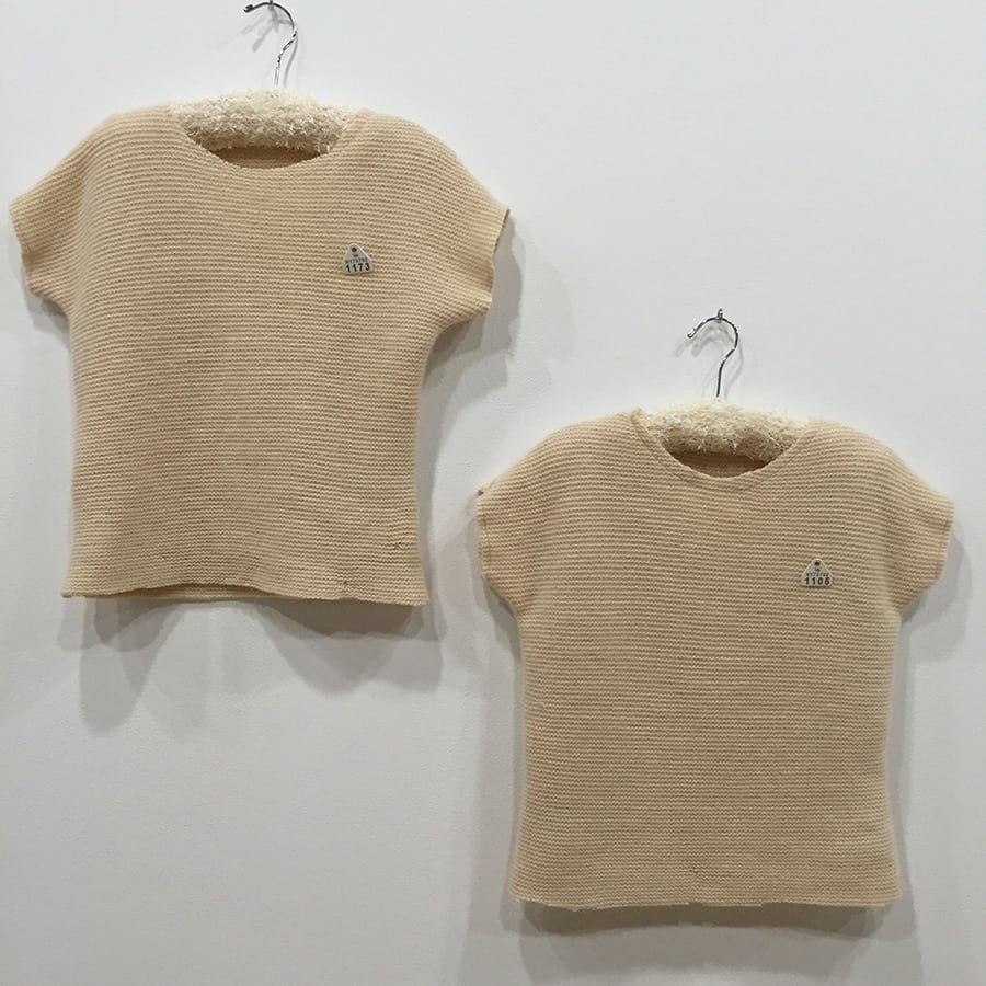 """Johanna Norry. Sweater: """"1173 and Sweater 1105."""" Recycled cashmere knit, recycled livestock ear tags, gold thread.23""""w x 54""""h. Image courtesy Marcia Wood Gallery."""