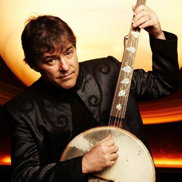Béla Fleck plays a banjo.