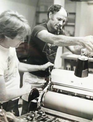 Micjael Goodman (foreground) working with Bill Burke on his first book with Nexus Press, 1983.