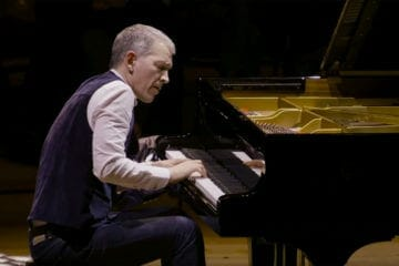"Jazz pianist Brad Mehidau, who composed ""The Folly of Desire,"" performs on a grand piano."
