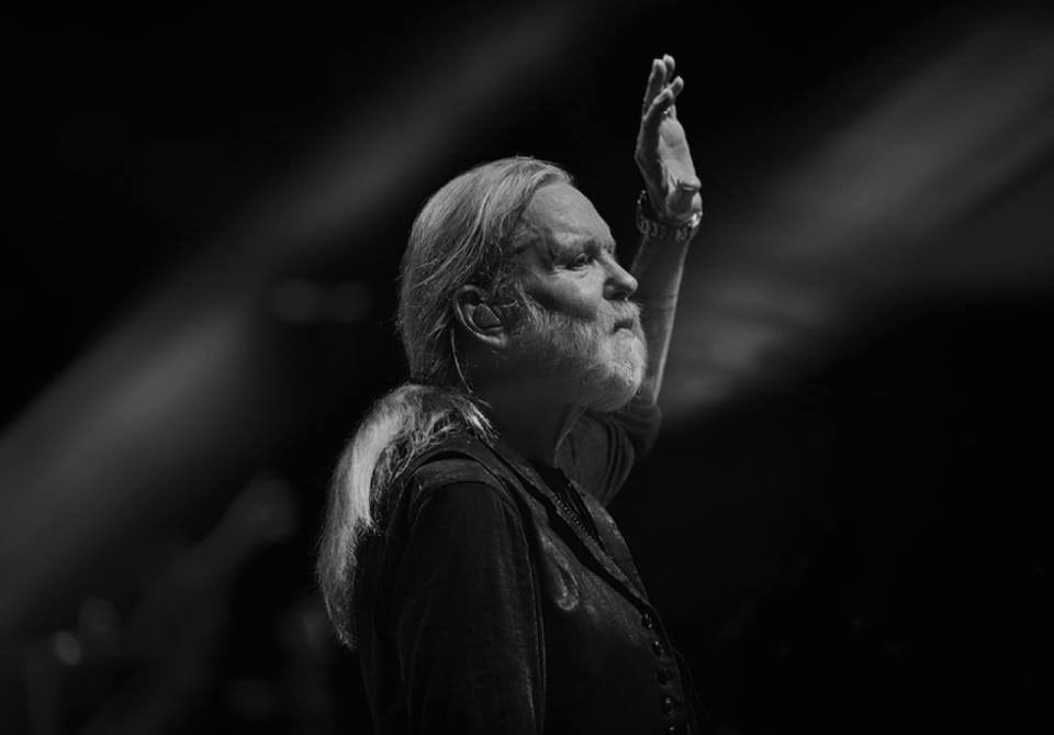 Shot of Gregg Allman waving goodbye to a concert crowd.