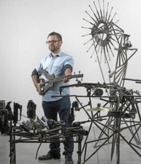 Pedro Reyes with some of the musical instruments from Disarm.