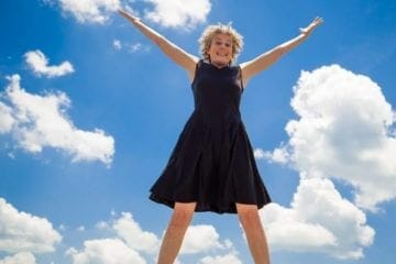Atlanta singer Elise Witt leaps in the air with joy.