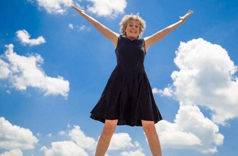 Atlanta singer Elise Witt leaps in the air with joy.