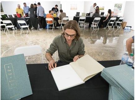 a participant enjoys a book fair