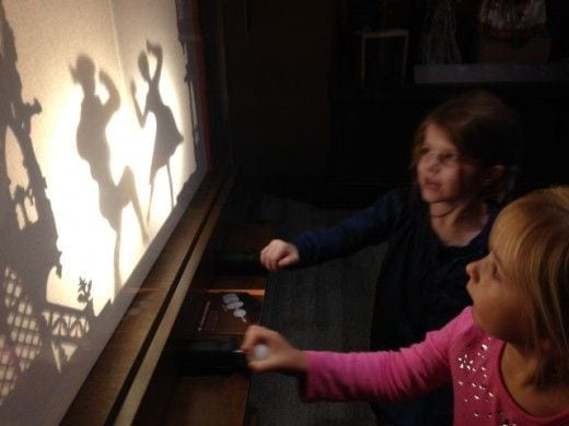 Visitors can manipulate shadow  puppets.