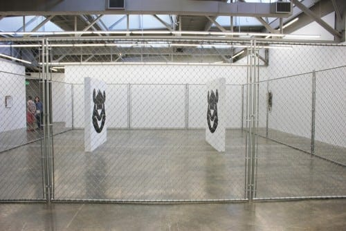 Kathryn Andrews: Friends and Lovers, 2010, chain link fence, concrete bricks, paint.