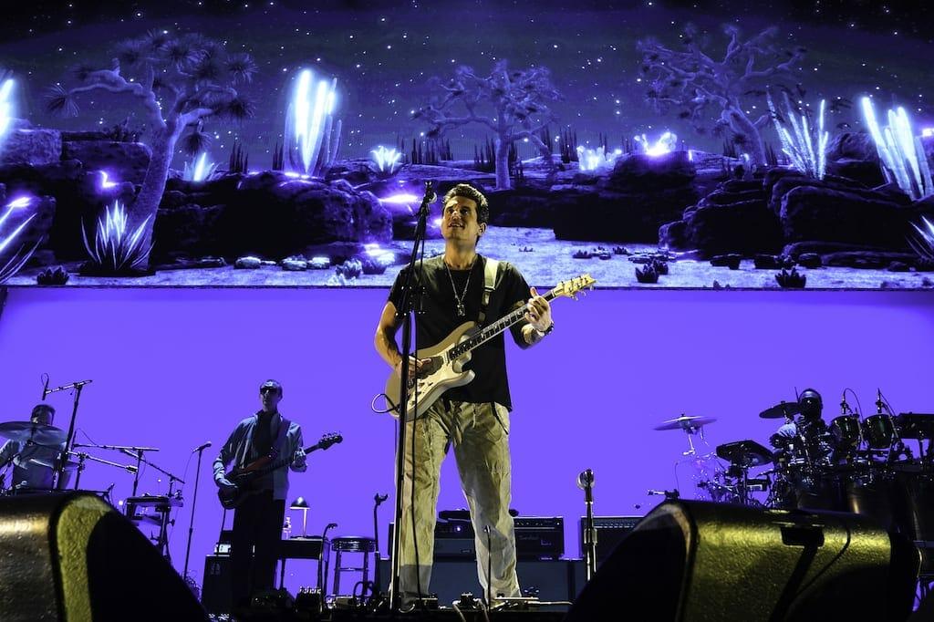 John Mayer plays his guitar
