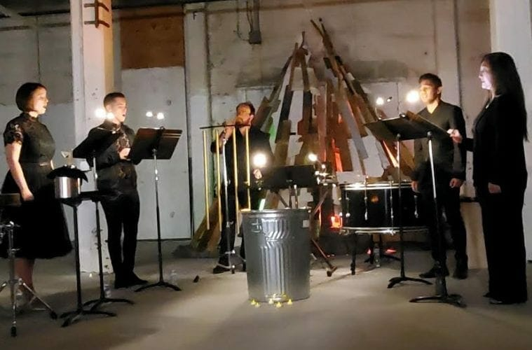The choral group Kinnara performs in a warehouse space at MINT gallery.