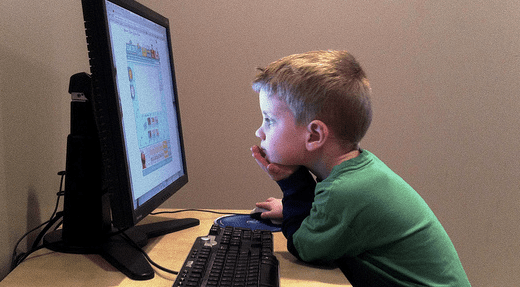 A child in front of a computer screen