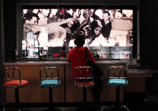 Visitors get a taste of a protester's experience at this simulated lunch-counter sit-in.