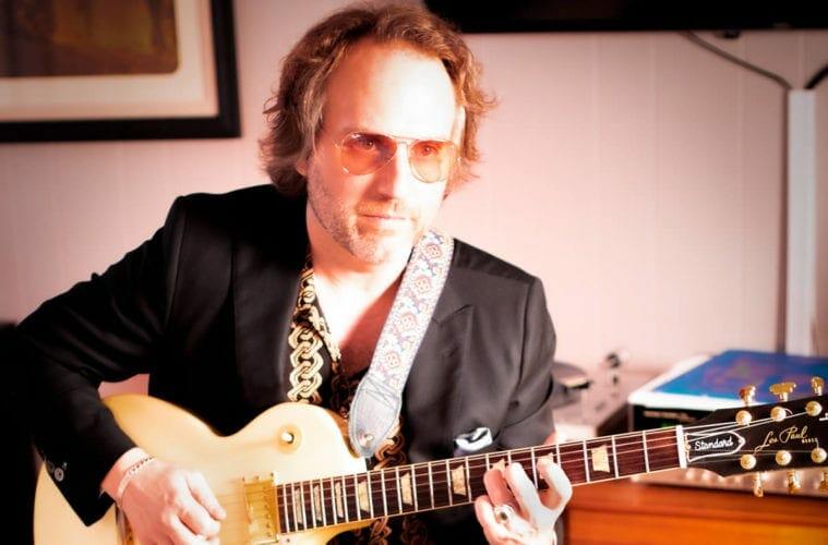 Mathis Hunter plays guitar
