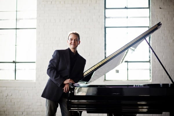 Internationally-acclaimed pianist Robert Henry performs with Suzuki students on Sunday.