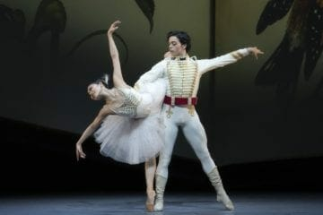 "Two dancers in white for Atlanta Ballet's ""The Nutcracker."""