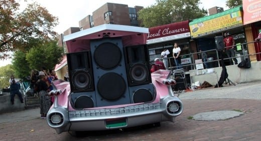 Otabenga Jones & Associates will produce a  radio station broadcast l from the back of a pink 1959 Cadillac.