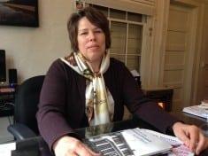 Elizabeth Wylie, new Andalusia director, sitting at Regina O'Connor's desk