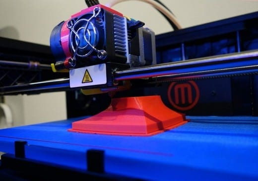 The MakerBot Replicator 2 prints objects out of bioplastic using a technology called Fused Deposition Modeling in which thin layers of plastic are laid down one at a time in order to build a 3-dimensional object.
