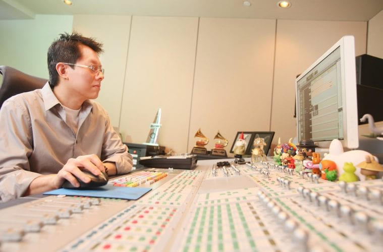 Sound mixer Phil Tan works in his studio.