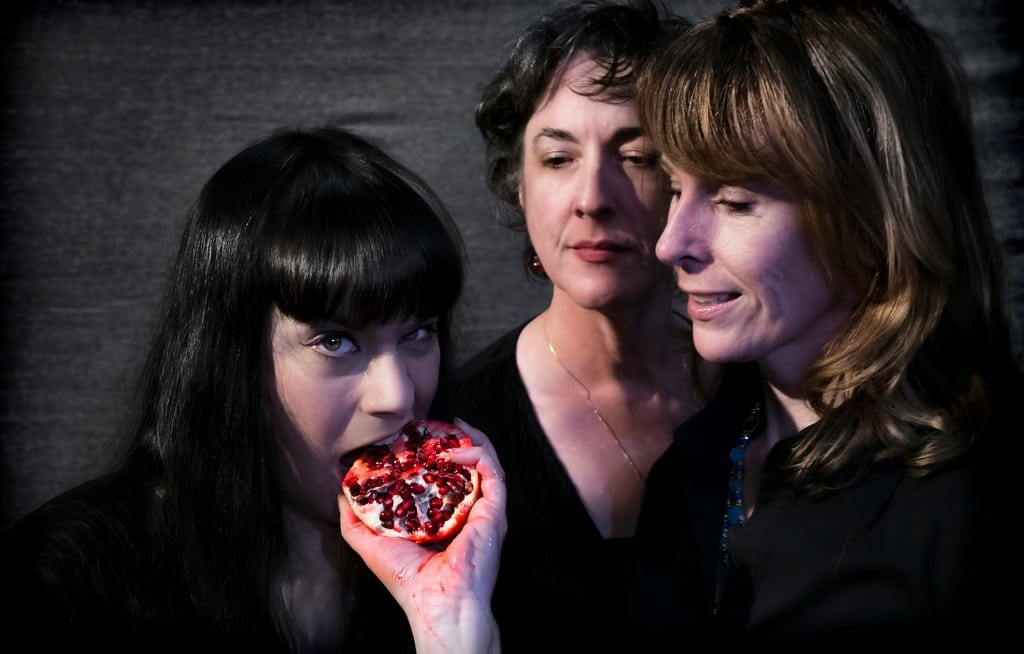 Gina Rickicki takes a bite from the forbidden pomegranate as Suzanne Roush and Jill Perry look on in Ravens and Seagulls. (Photo by StunGun Photography)