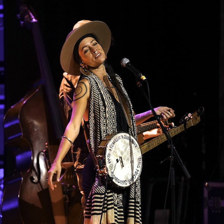 Leah Smith of Rising Appalachia plays the banjo.