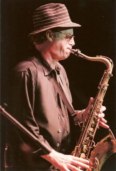 Hall is also an accomplished saxophonist.