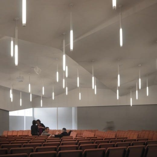 The sanctuary of Congregation Or Hadash Synagogue in a former body shop transformed by BLDGS.  (Photo by Fredrik Brauer)