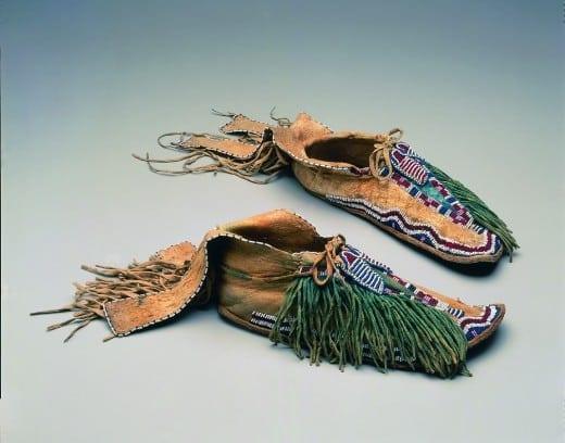 Moccasins, ca. 1870, Numunuu Comanche), Texas or Oklahoma, hide, glass beads, pigment.