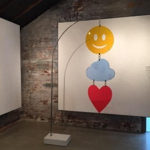 """""""Industrial Emoticon,"""" (2016). 93"""" X 58"""" X 12"""" Stainless steel, Elberton marble and plexiglass. Image courtesy Whitespace Gallery."""