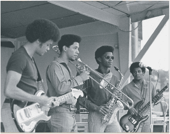 The Rev. Dwight Andrews as a youth playing on stage in his jazz ensemble.
