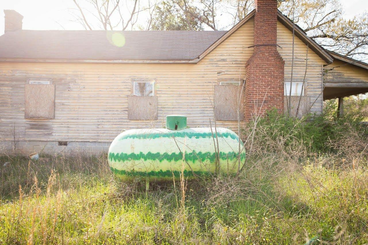 A photo by Amanda Greene of a watermelon-painted propane gas tank.