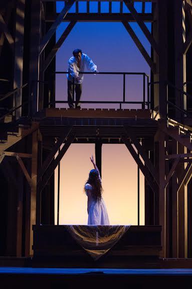 The set evokes Shakespeare's Globe Theatre.