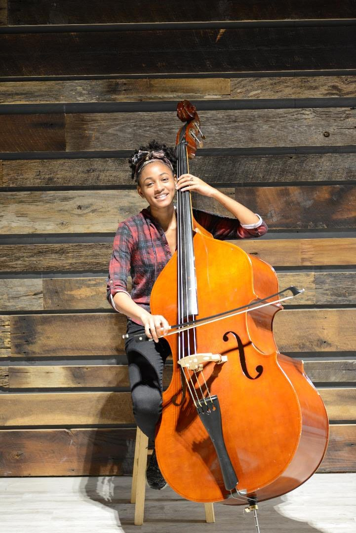 Alivia Carter plays her double bass in the new home of the Atlanta Music Project.