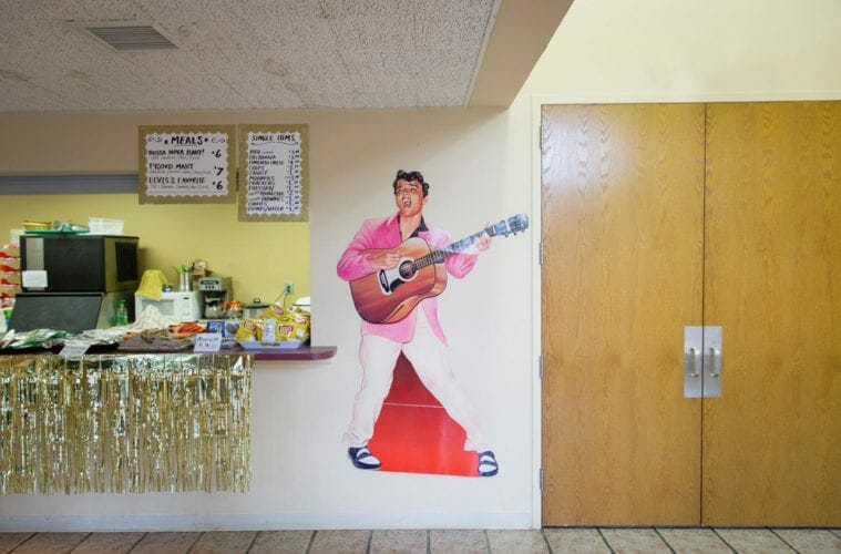 A photo of an Elvis poster in a country diner.