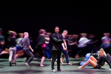Ivan Pulinkala surrounded by dancers.